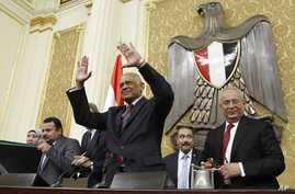 FILE - In this Jan. 10, 2016, photo, Ali Abdel-Al waves after being elected Speaker of Egypt's parliament, in Cairo, Egypt.