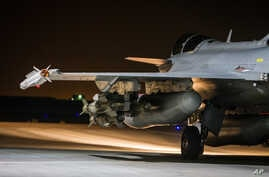 This photo released on Tuesday, Nov. 17, 2015 by the French Army Communications Audiovisual office (ECPAD) shows a French army Rafale jet on the tarmac of an undisclosed air base as part of France's Operation Chammal launched in September 2015 in sup