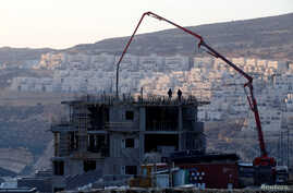 FILE - A construction site is seen in the Israeli settlement of Givat Zeev in the occupied West Bank, Dec. 22, 2016.