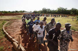 Malian women and men run during a training session at the FLN movement [North Liberation Forces] camp in Sevare, Mali, September 24, 2012.