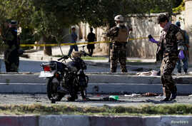 FILE - Afghan security forces inspect the site of a suicide attack in Kabul, Afghanistan Sept. 9, 2018.