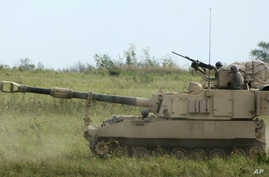 FILE - An Army Paladin self-propelled howitzer and its crew advances during a training exercise at Fort Riley, Kan., Sept. 12, 2012. The latest U.S. arms sale to Saudi Arabia, announced April 5, 2018, includes about 180 Paladin systems.