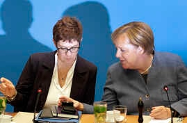 German Chancellor and chairwoman of the German Christian Democratic Union (CDU), Angela Merkel, right, and Annegret Kramp-Karrenbauer, left, Secretary General of the CDU, talk as they arrive for a closed-door meeting in Berlin, Germany, Sunday, Nov. ...