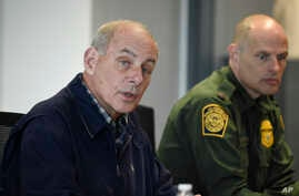 Secretary of Homeland Security John Kelly, left, speaks as Chief of U.S. Border Patrol Ronald Vitiello looks on during a meeting held at the San Ysidro Port of Entry, Feb. 10, 2017, in San Diego.