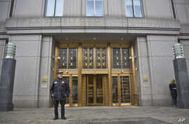 A court officer stands outside U.S. Federal Court, where two nephews of Venezuela's powerful first lady are facing arraignment after being arrested in Haiti, Nov. 12, 2015, in New York. An indictment unsealed on Thursday accuses Efrain Campos and Fra