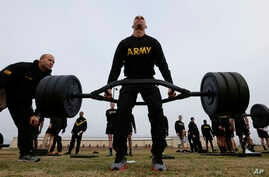 U.S Army 1st Lt. Mitchel Hess participates in a weight lifting drill while preparing to be an instructor in the new Army combat fitness test at Fort Bragg, N.C., Jan. 8, 2019. The new test is designed to be a more accurate test of combat readiness th