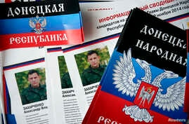 Election information sheets are on display during preparations for the upcoming election, with portraits of Alexander Zakharchenko, separatist leader of the self-proclaimed Donetsk People's Republic, seen on leaflets at a polling station in Donetsk,
