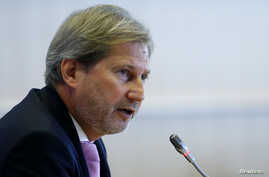 FILE - European Neighborhood Policy and Enlargement Negotiations Commissioner-designate Johannes Hahn of Austria addresses the European Parliament's Committee on Foreign Affairs, at the EU Parliament in Brussels, September 30, 2014
