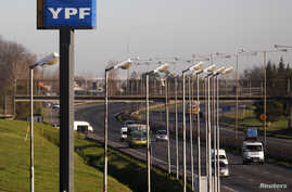 FILE - A sign of state-run energy company YPF is seen alongside a road in Buenos Aires Aug. 28, 2014.