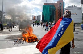 Protesters clash with riot police during a rally to demand a referendum to remove Venezuela's President Nicolas Maduro in Caracas, Venezuela.