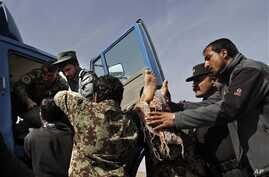 Afghan soldiers remove dead passenger from  truck after U.S. forces shot two passengers and injured another on road between Kabul and Bagram, March 11, 2013.