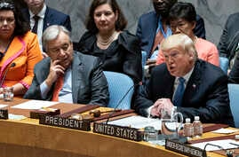 President Donald Trump addresses the United Nations Security Council during the 73rd session of the United Nations General Assembly, at U.N. headquarters in New York, Sept. 26, 2018. Left is United Nations Secretary-General Antonio Guterres.