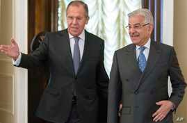 Russian Foreign Minister Lavrov, left, welcomes Pakistan's Foreign Minister Khawaja Muhammad Asif for their talks in Moscow, Russia, Feb. 20, 2018.