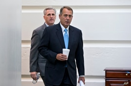 Speaker of the House John Boehner, R-Ohio, with House Majority Whip Kevin McCarthy, R-Calif., left, walks to a meeting of House Republicans at the Capitol in Washington, Oct. 15, 2013.