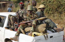 FILE - Seleka rebels are seen driving through Bangui, Central African Republic, Jan. 27, 2014.