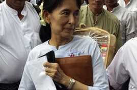 Burma's democracy icon Aung San Suu Kyi leaves her National League for Democracy party's headquarters on Friday, Nov.19, 2010, in Rangoon.