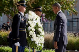 President Barack Obama pauses as he lays a wreath during a memorial observance ceremony at the Pentagon, Sunday, Sept. 11, 2016, to commemorate the 15th anniversary of the 9/11 terrorist attacks.