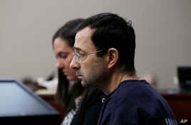 Dr. Larry Nassar is seated during the seventh day of his sentencing hearing, Jan. 24, 2018, in Lansing, Mich.
