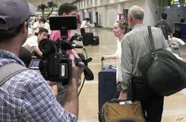 In this image made from video, U.S. citizen and aid worker Heidi Linton of Christian Friends of Korea, second from right, speaks to reporters after arriving at Beijing International Airport from Pyongyang, North Korea, Aug. 31, 2017.