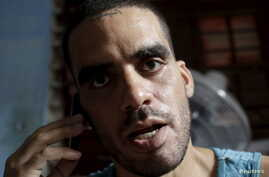 Cuban graffiti artist Danilo Maldonado speaks on his cellphone in his house in Havana, Oct. 20, 2015. Maldonado has been detained by the government after making a video celebrating the death of Fidel Castro.
