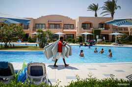 FILE - Tourists relax in a pool in the Red Sea resort of Hurghada, Egypt, August 15, 2016.