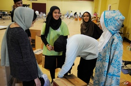Volunteers with the Islamic Society of Greater Houston, pack donations at a mosque that was being used as a shelter, in Houston, Texas, Aug. 31, 2017.