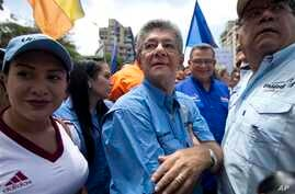 Venezuelan National Assembly President Henry Ramos Allup, center, takes part in a protest march in Caracas, Venezuela, July 27, 2016.