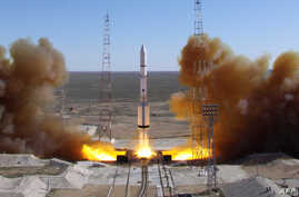 FILE - A Russian-built Proton rocket with Russian relay satellite Luch-5V and the Kazakh communication satellite KazSat-3 aboard blasts of from a launch pad in the Russian leased Kazakhstan's Baikonur cosmodrome, April 28, 2014.