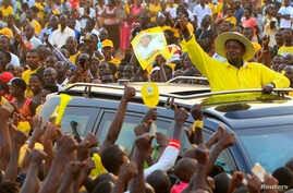 Uganda's President and the presidential candidate Yoweri Museveni of the ruling party National Resistance Movement (NRM) waves to his supporters as he arrives at a campaign rally ahead of the February 18 presidential elections in Entebbe, Uganda Febr...