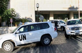 FILE - A convoy of chemical weapons disarmament experts depart the Four Seasons Hotel in Damascus, Syria, Oct. 8, 2013. Activists say they have documented 18 cases of chlorine gas used in the country's rebel-held north since March 6, 2015.