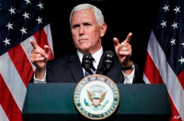 FILE - In this Aug. 9, 2018 photo, Vice President Mike Pence gestures during an event on the creation of a U. S. Space Force at the Pentagon.