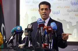 Emad Al-Sayh, chief of Libya's High National Election Commission, speaks during a press conference in the capital Tripoli on Dec. 6, 2018.