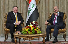 U.S. Secretary of State Mike Pompeo meets with Iraq's President Barham Saleh in Baghdad, Iraq, during a Middle East tour, Jan. 9, 2019.