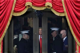 President-elect Donald Trump waits to stop out onto the portico for his Presidential Inauguration at the U.S. Capitol in Washington,  Jan. 20, 2017.