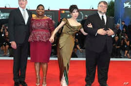 "FILE - Director Guillermo Del Toro, from right, actors Sally Hawkins, Octavia Spencer and Richard Jenkins pose for photographers upon arrival at the premiere of the film ""The Shape of Water"" during the 74th edition of the Venice Film Festival in Veni"