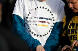 A student wears a shirt printed with a message during the kickoff event for the Vote For Our Lives movement to register voters, April 19, 2018, at Clement Park in Littleton, Colo. The event was held on the eve of the 19th anniversary of the shootings