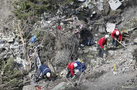 French rescue workers inspect the remains of the Airbus A320 at the site of the crash near Seyne-les-Alpes, French Alps, March 29, 2015.