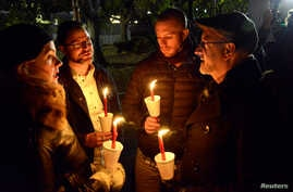 Demonstrators hold a candlelight vigil against President-elect Donald Trump's election, in Lafayette Park, near the White House, in Washington, Nov. 12, 2016.