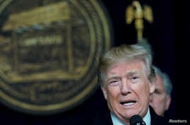 U.S. President Donald Trump speaks to reporters after a congressional Republican leadership retreat at Camp David, Md., Jan. 6, 2018.