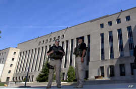 U.S. Marshalls guard the area outside of the federal U.S. District Court in Washington Saturday, June 28, 2014,  in anticipation of a  court appearance by captured Libyan militant Ahmed Abu Khattala
