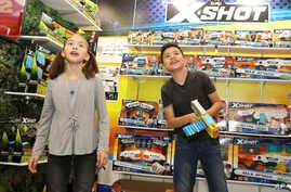 A brother and sister check out the latest gadgets at the 115th North American International Toy Fair, in New York, Feb. 17, 2018.