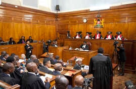 Kenyan Supreme Court judges deliver their detailed ruling concerning the August presidential elections, at the Supreme Court in Nairobi, Kenya, Sept. 20, 2017.