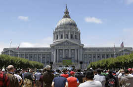 Brazil WCup US SoccerFILE - San Francisco City Hall is seen in a July 1, 2014, photo. City officials are to vote Tuesday on a proposal to clarify guidelines under which federal deportation authorities should be contacted if an immigrant in the U.S. i