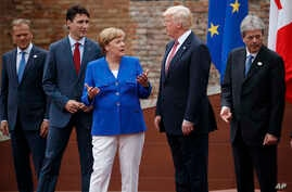G7 leaders, from left, President of the European Commission Jean-Claude Junker, Canadian Prime Minister Justin Trudeau, German Chancellor Angela Merkel, President Donald Trump, and Italian Prime Minister Paolo Gentiloni, pose for a family photo at th...
