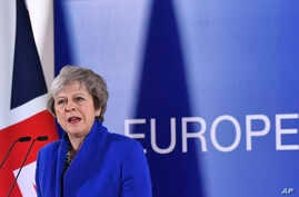 FILE - British Prime Minister Theresa May speaks during a media conference at the conclusion of an EU summit in Brussels, Nov. 25, 2018.