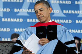 President Barack Obama reads over a program before delivering the commence address at Barnard College, NY, May 14, 2012.