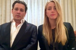 In this image made from video released by the Australian Government Department of Agriculture and Water Resources on Monday, April 18, 2016, actor Johnny Depp and his wife, Amber Heard speak in a videotaped apology played during Monday's hearing at t