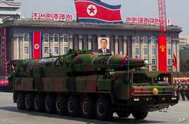 North Korean vehicle carrying a missile passes by during a mass military parade in Pyongyang's Kim Il Sung Square to celebrate the centenary of the birth of the late North Korean founder Kim Il Sung, April 15, 2012.