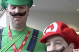Attendees at Comic Con in San Diego dress up as the Mario brothers game characters.