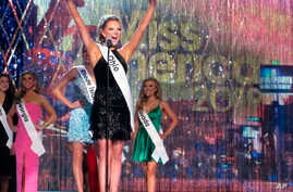 Miss Ohio Matti-Lynn Chrisman introduces herself at the start of the third and final night of preliminary competition at the Miss America competition in Atlantic City, N.J., Sept. 7, 2018.